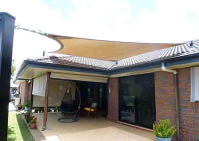 Shade sail over patio area - Z16 Desert Sand with black